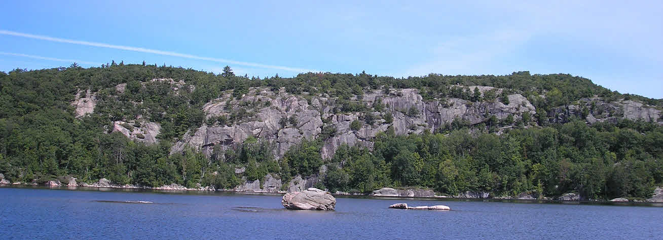 Lake with rock cliff